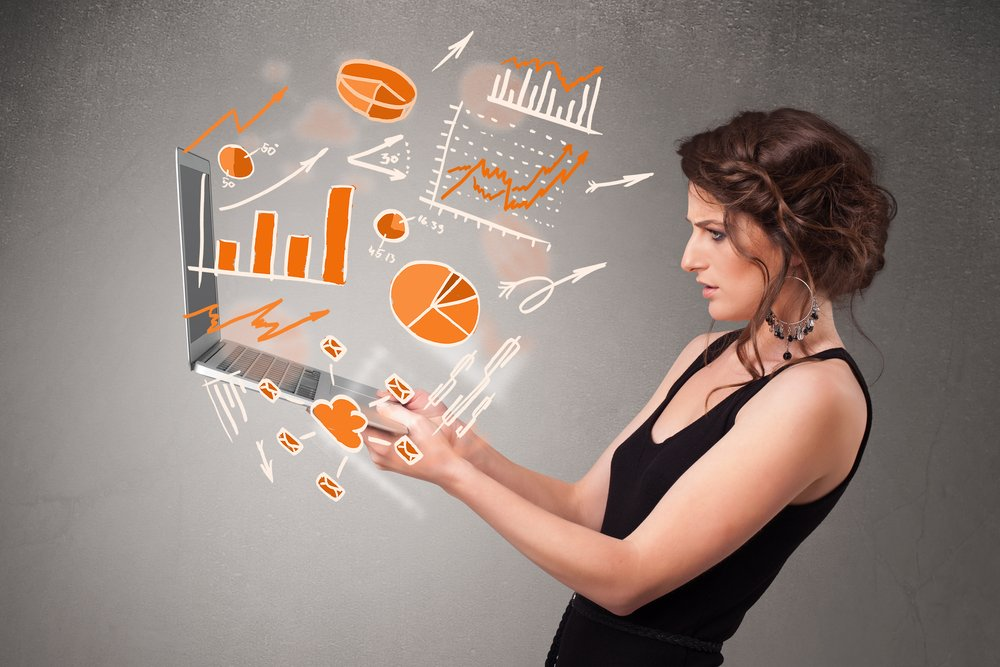 Beautiful-young-lady-holding-laptop-with-graphs-and-statistics