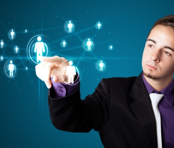 Businessman-pressing-modern-social-buttons-on-a-virtual-background