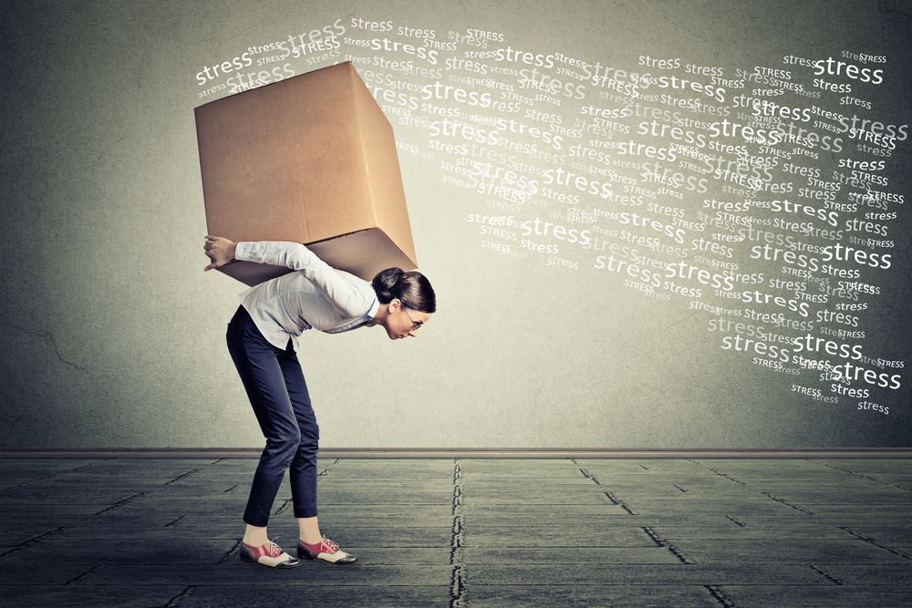Stressed-woman-carrying-on-her-back-shoulders-large-box