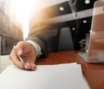 double-exposure-of-businessman-or-salesman-handing-over-a-contract-on-wooden-desk-1