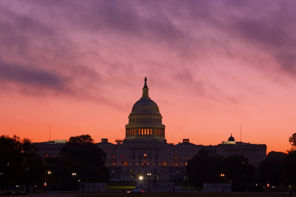 Alarmingly bright sunrise above US Capitol Dome. U.S. Capitol Dome Restoration project is nearing its completion.