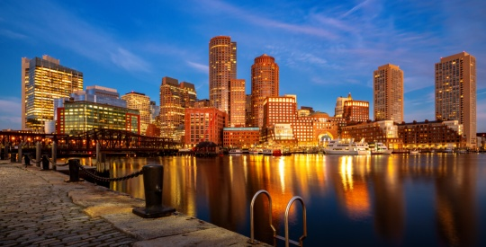 Boston harbor with cityscape and skyline on sunset